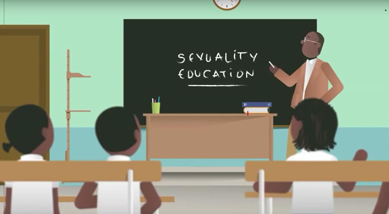 Barn i klassrum med lärare vid skrivtavla