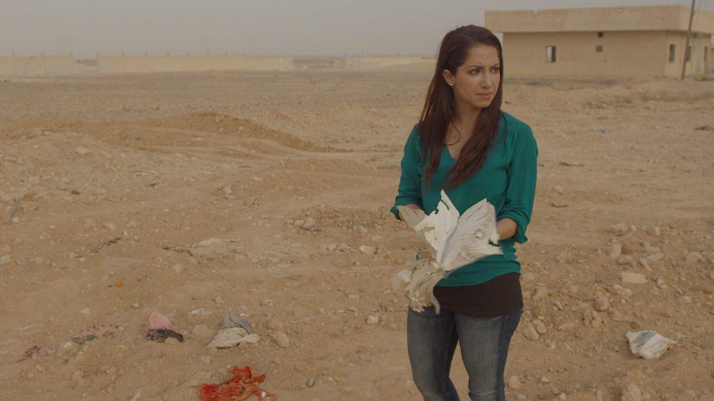 Bilden är hämtat från första avsnittet i SVT's  dokumentärserie Kultur i farozonen där Khazar besöker världsarvet Palmyra i Syrien.  Den sönderskjutna dagboken följer med henne hem till Sverige och har använts under föreläsningarna runt om i landet.   foto: Clas Elofsson